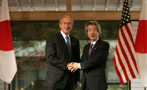 President George W. Bush and Prime Minister Junichiro Koizumi of Japan, shake hands Wednesday, Nov. 16, 2005, prior to their meeting at the Kyoto State Guest House in Kyoto, Japan. White House photo b