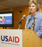 Under Secretary Hughes speaking at podium during USAID reception in recognition of International Womens Day photo: USAID/Tyller Mallory