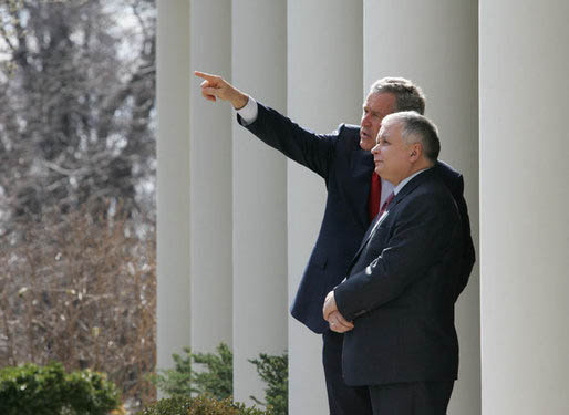 President George W. Bush shows Polands President Lech Kaczynski points of interest around the White House from the Rose Garden steps,  Feb. 9, 2006 in Washington. White House photo by Eric Draper.