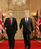President George W. Bush and Prime Minister Tony Blair of Great Britain, walk through Cross Hall en route to the East Room for a joint press availability. White House photo by Shealah Craighead