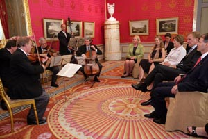 First Lady Laura Bush listens to members of the Vienna Philharmonic String Quartet play
