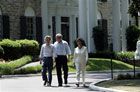 Japanese Prime Minister Junichiro Koizumi, left, along with President Bush and first lady Laura Bush, leave Graceland. [�AP/WWP]