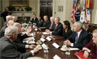 President Bush, right center, is flanked by Vice President Dick Cheney, left, and Secretary of State Condoleezza Rice, right, at the White House, Thursday, Jan. 5, 2006. [� AP/WWP]