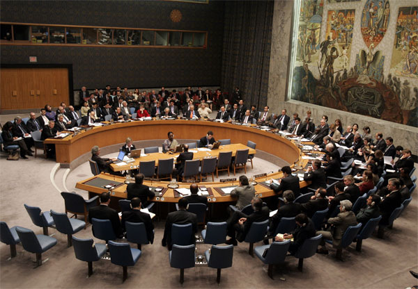 Syria's United Nations Ambassador Fayssal Mekdad, at end of the circular table, foreground left, addrreses the UN Security Council, Tuesday Oct. 25, 2005. [� AP/WWP File Photo]