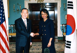 Secretary Rice greeting South Korean Foreign Minister Ban Ki-Moon to the U.S. Department of State during a January 19, 2006 visit. [State Department photo]