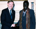 Deputy Secretary Zoellick greeting Rebecca Garang, Sudanese Minister of Roads. [State Department photo]
