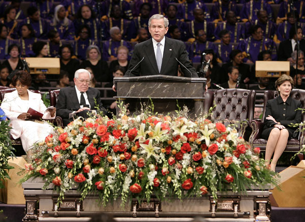 President Bush, center, praises the life of Coretta Scott King during funeral services at New Birth Missionary Baptist Church Tuesday, Feb. 7, 2006 in Lithonia, GA. [� AP/WWP]