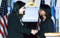 Secretary Rice shakes hands with Greek Foreign Minister Theodora Bakoyannis. Washington, DC. March 23, 2006. State Dept. photo.