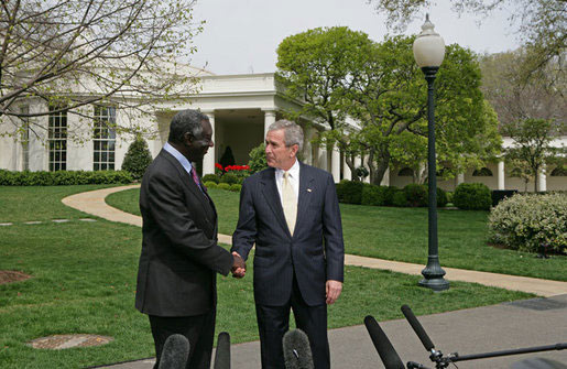 After meeting in the Oval Office, President Bush and President Kufuor of Ghana shake hands during a joint statement to the press on the South Lawn April 12, 2006. White House photo by Kimberlee Hewitt