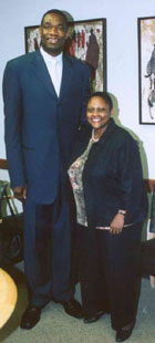 Asst. Sec. Frazer with Dikembe Mutombo at State Department, May 25, 2006