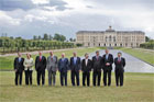 The G8 leaders pose for a photograph at Konstantinvosky Palace in Strelna, Russia, Sunday, July 16, 2006. From left, they are: Italian Prime Minister Romano Prodi; German Chancellor Angela Merkel; British Prime Minister Tony Blair; French President Jacques Chirac; Russian President Vladimir Putin; President George W. Bush; Japanese Prime Minister Junichiro Koizumi; Canadian Prime Minister Stephen Harper; Finnish Prime Minister Matti Vanhanen; and European Commission President Jose Manuel Barroso. White House photo by Paul Morse