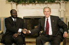 President George W. Bush welcomes Salva Kiir, the First Vice President of the Government of National Unity of Sudan and the President of Southern Sudan, during a meeting in the Oval Office Thursday, July 20, 2006. White House photo by Eric Draper.