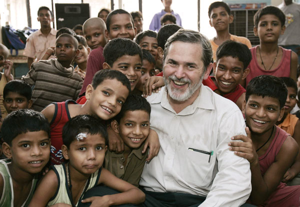 U.S. Assistant Secretary of State for South and Central Asia Richard Boucher poses with children at the Salaam Baalak Trust in New Delhi, India, Saturday, Aug. 5, 2006. Boucher visited the shelter for