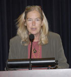 Michele Moloney-Kitts offers a welcome and a brief overview of the AIDS