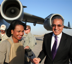 Secretary Rice arrived to Baghdad, Iraq for meetings with political leaders on October 5, 2006. She was greeted by U.S. Ambassador Dr. Zalmay Khalilzad (right). [State Department photo by Josie Duckett]