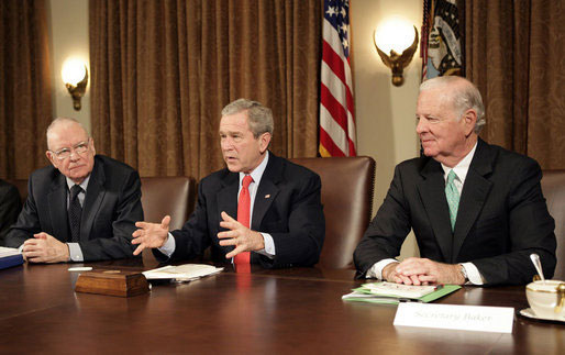 President George W. Bush addresses the press during a meeting with the Iraq Study Group in the Cabinet Room Wednesday, Dec. 6. 2006. Pictured with the President are the group's co-chairmen former Representative Lee Hamilton, left, and former Secretary of State James Baker.
