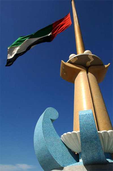 An United Arab Emirates flag flies at half staff in Dubai Wednesday Jan. 4, 2006, to mark the death of Sheik Maktoum bin Rashid Al Maktoum. [� AP/WWP]