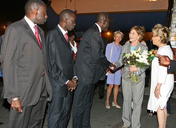 First Lady Laura Bush visits Senegal - greeted at Dakar Airport by Senegal's First Lady.