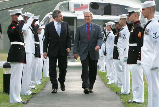 President Bush and Prime Minister Gordon Brown of the United Kingdom, walk past an honor guard July 29, 2007, after the Prime Ministers arrival at Camp David, MD. White House photo by Chris Greenberg