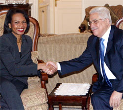 Secretary Rice, left, shake hands with Palestinian President Mahmoud Abbas, right, during their meeting in Amman, Jordan March 26, 2007. [© AP Images]