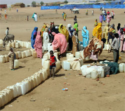Darfur refugees line up for water at a refugee camp, north Darfur, Sudan on March 24, 2007. [� AP Images file photo]