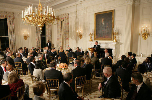 President George W. Bush welcomes guests to the Iftaar Dinner with Ambassadors and Muslim leaders in the State Dining Room of the White House, Thursday, Oct. 4, 2007. [White House photo by Chris Greenberg]
