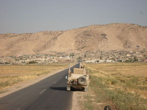 Ninawa Province Iraq. Convoying to Dahuk Province, the PRTR Military Movement makes a momentary stop along the road, just south of the provincial border. [Oct. 4, 2006]