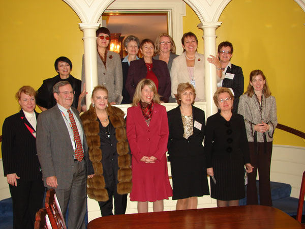 Russian businesswomen pose with Andrea Bottner, Senior Coordinator for International Womens Issues [center]; Ambassador Steve Steiner [left]; Lucy Weber, Bureau of Educational and Cultural Affairs [far right]; and Connie Phlipot, Policy Planning staff [top row, 2nd from right].