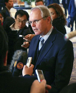 Assistant Secretary Christopher R. Hill briefs journalists at the St. Regis hotel in Beijing.  [© AP Images]