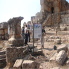 Tourists read the information panels at the Sfire Roman Temple in North Lebanon.