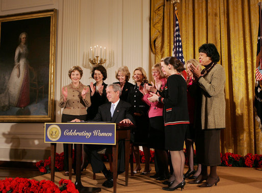 President George W. Bush is applauded by Mrs. Laura Bush, Cabinet members and members of Congress, at the proclamation signing for Womens History Month Monday, March 10, 2008 in the East Room of the