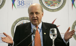 Deputy Secretary Negroponte answers questions during a news conference at the 38th OAS General Assembly in Medellin, Colombia. [© AP Images]