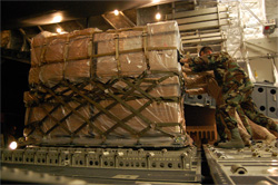 Crewmembers of C-17 Globemaster aircraft unload a pallet of humanitarian supplies in Tblisi, Georgia, Aug. 13, 2008. Dept. of Defense photo by Navy Lt. Cmdr Corey Barker.