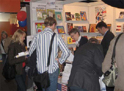 Visitors at the Frankfurt International Book Fair look over materials and chat with IRC staff, October 25, 2007. [Joshua Kennedy, U.S. Consulate Frankfurt]