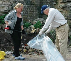 Ambassador Phillips and Mrs. Phillips in action cleaning an illegal dumpsite near the U.S. Embassy in Tallinn, May 3, 2008. [DCM Karen Decker, U.S. Embassy Tallinn]
