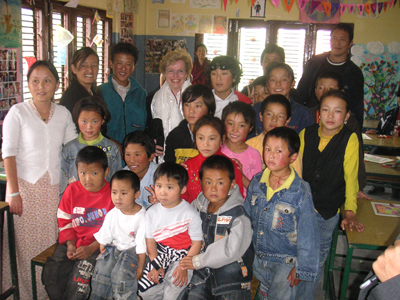 "Assistant Secretary Sauerbrey is surrounded by Tibetan children participants at a children's ""Art Refuge."" [State Dept. Photo]"