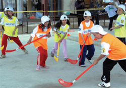 "Kids play field hockey at the ""Healthy Kids, Healthy Environment"" camp, May 2008. [Ryan Rowlands, U.S. Embassy Skopje]"