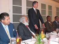 U.S. Attorney Thomas O'Brien addresses a luncheon to discuss the Public Private Partnership. From left to right: Afghan Consul General Atiqullah Atifmal, Former Attorney General Abdul Jabbar Sabit, U.S. Attorney Thomas P. O'Brien (standing), two members of the Los Angeles Joint Terrorism Task Force.