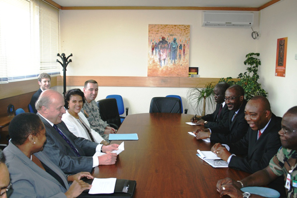 Deputy Secretary Negroponte (center left) heads a meeting with local Ivorian officials along with Assistant Secretary Frazer (grey jacket) and Ambassador Nesbitt (white jacket).