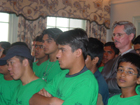 July 13, 2004 -- Group of Indian, Pakistani and Afghan Seeds of Peace campers stand with David Good, Director, Office of India, Nepal and Sri Lanka Affairs during welcome remarks at the State Department.