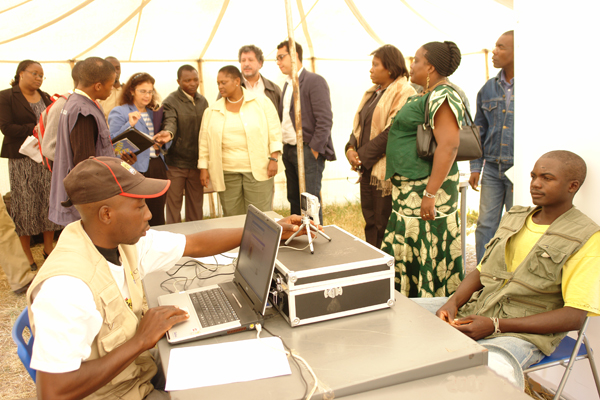 Assistant Secretary Frazer in Angola at voters registration site.