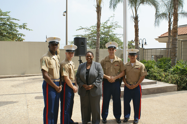 Assistant Secretary Frazer With the U.S. Marine Security Guard Detachment in front of the U.S. Embassy in Luanda.