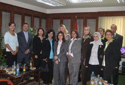Andrea Bottner, back row center, and Deborah Emmert, far left, meet with nine of Egypt's recently-appointed female judges in Cairo. Also in the meeting is Assistant Minister of Justice Osama Ataweya, second from left. [Photo courtesy of May Abdeldayem, U.S. Embassy in Cairo, July 15, 2008]