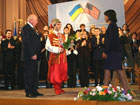 A student dressed in traditional Ukrainian Cossack costume presents Secretary Rice with flowers following her town hall meeting with students at Shevchenko University in Kiev, Ukraine on Dec. 7.