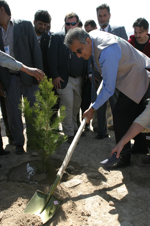 Kabul, March 20 - U.S. Ambassador to Afghanistan Zalmay Khalilzad planting a tree on Afghan New Year's Day, at the inauguration of Kabul Green Week, an initiative to educate Kabul's citizens on how to preserve and protect the environment. The United States government - through the U.S. Agency for International Development - has contributed almost $1 million towards tree planting to restore the natural beauty of Afghanistan's capital, Kabul.