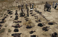 Examination of mass grave sites by the coalition team and local Iraqis. CPA photo