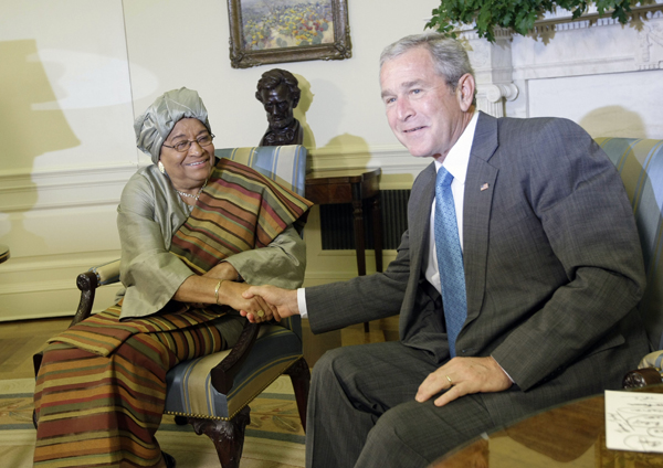 President Bush, right, shakes hands with Liberian President Ellen Johnson Sirleaf, left, during their meeting in the Oval Office of the White House in Washignton, Thursday, Oct. 18, 2007. (AP Photo/Pablo Martinez Monsivais)
