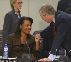 Secretary Rice speaks with Secretary General de Hoop Scheffer while visiting the NATO headquarters on Friday, December 7, 2007.  State Department photo by Didier Vandenbosch.