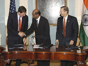 Under Secretary of State Marc Grossman, Indian Foreign Secretary Shyam Saran, and Under Secretary of Commerce Kenneth Juster.
