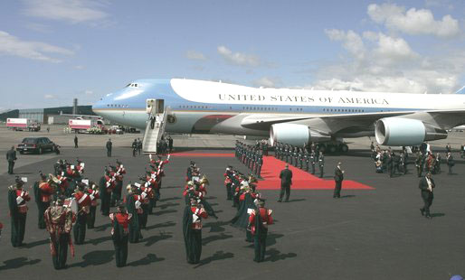 As President George W. Bush and Laura Bush disembark Air Force One, a band is poised for their arrival at Glasgows Prestiwick Airport.  [White House photo by Paul Morse, July 6, 2005]